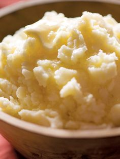 To keep mashed potatoes warm until the meal is served, place them in a heat-proof bowl and cover with foil. Set that bowl in a pot of barely simmering water that reaches halfway up the side of the bowl. Recipe: Tom's Perfect Mashed Potatoes   - CountryLiving.com