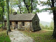 Monte Sano State Park in Huntsville, Alabama. Love the stone cabins. That would be ideal. Better get good at masonry.
