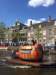 A man, riding a giant Heineken barrel down a canal. Amsterdam Canals, I Amsterdam, Travel Album, Holland Netherlands, Boat Interior, Castle House, Most Beautiful Cities, Dream Vacations, Wonders Of The World