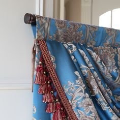 Unusual Swag Jabot Treatment With Rod Supported By