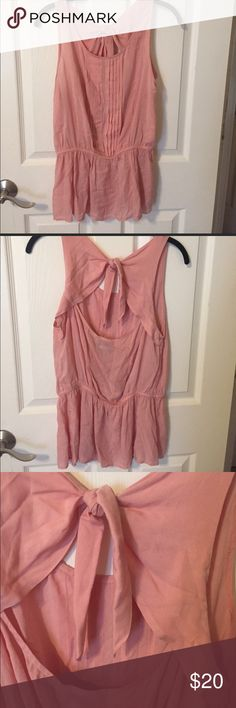 Anthropologie pink back tie blouse Adorable size US 10 blouse with back tie! Has clips for bra straps for no show effect! Elastic waist line means it can fit many sizes! Used- good condition. I will steam before shipping! Anthropologie Tops Blouses