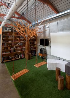 AgencyNet - love the swings, the carpet that looks like grass and the wood stumps.