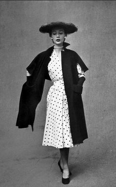 1951 Sophie Malgat is wearing a cape-stole that looks like a long coat in front and a shawl in back by Piquet,