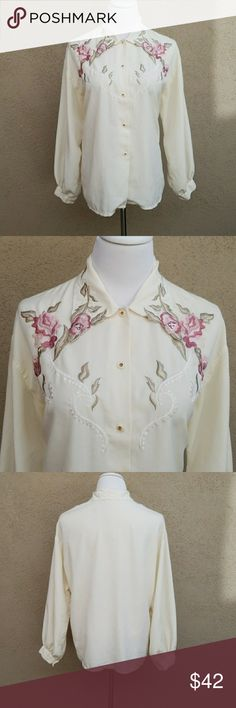 Floral Embroidered Blouse with Buttons This is a gorgeous rare piece! Flower embroidery on shirt and collar and has white buttons with gold detail.  A Japanese brand that fits like a medium or large but I can wear it as a small. The color is inbetween a white and a cream for a very subtle bit of color. It's chic and can be styled professional or casually. Wear it unbuttoned or buttoned. Soft and falls beautifully. Tops Button Down Shirts