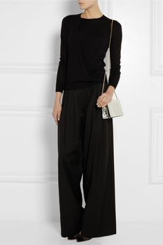 Shown here with: Eddie Borgo ring, J.W.Anderson pants, Gianvito Rossi shoes, Stella McCartney bag.