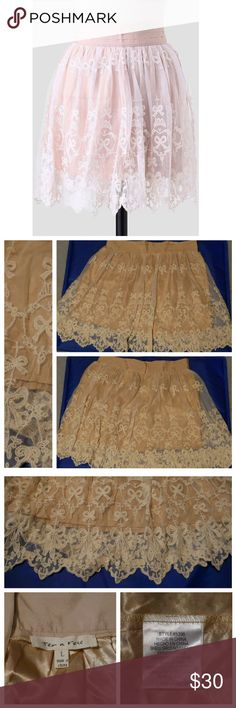 Country Picnic Embroidered Skirt New. Never worn. Great condition. This silky beige skirt features an ivory-hued mesh overlay with floral and bow embroidery throughout.  Scalloped hem and a pleated, banded waist for a refined silhouette. tea n rose Skirts