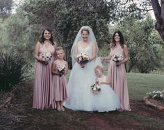 Stunning Joanne's hunter valley vintage vineyard wedding looks amazing with her gorgeous bridal party wearing their @Goddess By Nature signature ballgowns in the dust me pink colour and her cute little flowergirl, just beautiful! www.goddessbynature.com <3 we post worldwide #goddessbynature #goddessbynaturedress #goddessdress #1dress50ways #multifunctionaldress #multiwaydress #bridesmaids #weddings #bridalparty #bridesmaidsdress #pink #flowergirl #juniorbridesmaids
