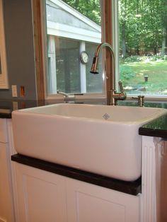 upmounted shaws sink with granite drip rail
