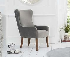 Linda Grey Velvet Accent Chair with plush Grey Velvet upholstery, a winged shape, wooden legs and studded trims