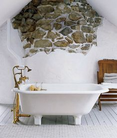 stone exposed wall and tub