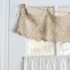 Wonderful way to use a vintage lace runner.....very cute are the clothespins!