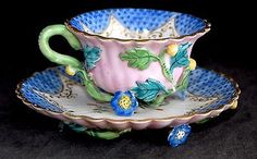Antique MEISSEN Floral Encrusted and Exotic Bird Decorated Cup and Saucer