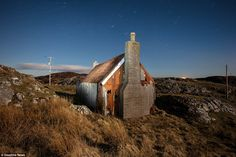 The exterior of the MacKinnon's home on the Isle of Harris - like many it had a corrugated...