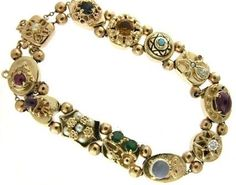 Vintage, circa 1950, 14k yellow gold multi-gem slide bracelet.