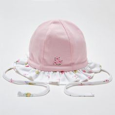 An adorable floppy hat for baby girls by Kissy Kissy. Made with 100% soft Peruvian pima cotton for softness and comfort. A sweet embroidered flower motif on one sider and prints of summer bugs on the reverse side. The hat secures with a tie under the chin. Perfect for protecting baby's delicate head on sunny …