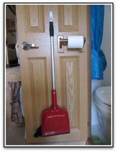 Camper / RV organization broom on back of closet door