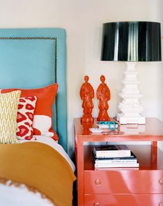 Love how the walls are simple and the furniture and bedding brings the color to the room