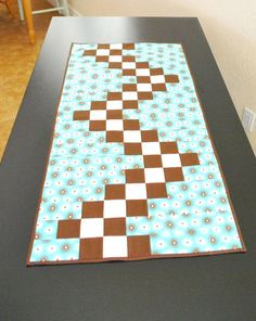 Neat pattern in this Quilted Table Runner  Modern Flower teal brown by MonkeyMuffin on Etsy