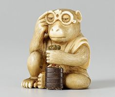 A Tokyo school ivory netsuke of a monkey with an inrô, by Yoshiyuki. Ca. 1960-1970