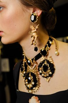 Dolce & Gabbana ...want that collar necklace..earrings are a little too much