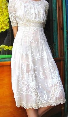 vintage white embroidered dress.  In a darker color for fall wedding?