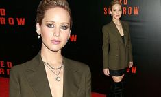 Jennifer Lawrence flashes legs in short skirt and black boots