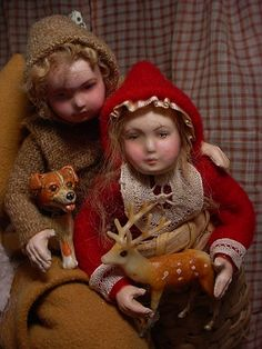 No, these are not the same dolls, this is another walking Santa and the children in his basket.  They are very similar, but not identical, both sold.  (decamp)