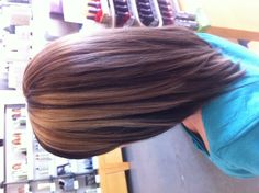 Medium blonde highlights with lowlights. Aveda color. Long swing bob.