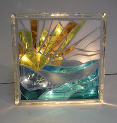 Two pieces of art for the price of one! Done on both sides of a glass block,this soothing and beautiful light will add a modern touch to your kitchen, living room, bathroom or next to your bed. Made of stained glass, cut, glued and grouted, with a seal to keep it beautiful for a long