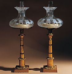 Pair of small columnar sinumbra (sperm oli) lamps. Gilt bronze and brass, with lamp mechanism and glass shades, blown frosted and wheel-cut, and glass chimneys, By Cornelius and Co. circa 1827-1831