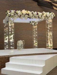 This custom built acrylic chuppah with floating orchid strands is the stuff dreams are made of!