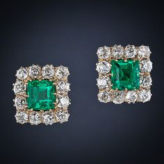A pair of vivid crystalline green (gem color) old-mine Colombian emeralds weighing just under 4.00 carats total weight (2.04 and 1.79 carats, respectively) radiate from the centers of sparkling diamond frames in these classic Victorian earrings, circa 1890. The 18K gold frames contain 4.00 carats of quality old mine-cut diamonds. Ravishing, rare and wonderful!