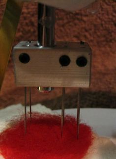 convert an old sewing machine into a needle felting machine.