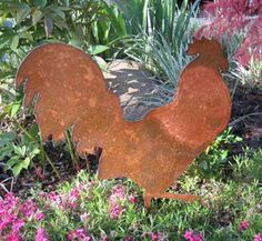 leesfamous.com   http://www.etsy.com/listing/74469693/rooster-garden-stake-garden-art-chicken