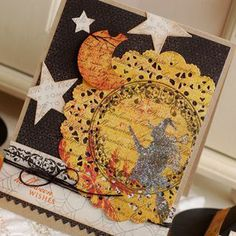 Halloween card.  Would never think to distress, stamp and color a doily for Halloween.  A-mazing!