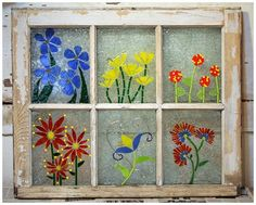 Beautiful faux stained-glass window made from an old wood framed window
