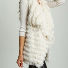 Ivory Faux Fur Vest NWT This ivory faux fur vest is so soft. Drapey at the front to add visual interest. So comfy and perfect to pair over your favorite top or dress. Brand new. Jackets & Coats Vests