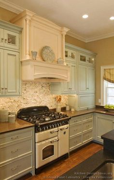 Vintage kitchen - so pretty -- love the vintage style stove, colors and tile backsplash.