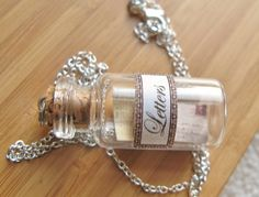 Emily's Love Letters - Nostalgic Miniature Jar Necklace - Message in a Bottle. $14.00, via Etsy.
