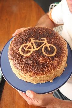 cocoa sprinkled on a card stock bicycle= super easy topper! hello perfect for my husband!!