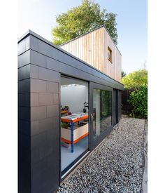 Moon Design + Build has used Marley Eternit's Thrutone fibre cement slates to create stunning vertical cladding on the Garden Studio project...