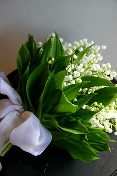 Romantic Hand Tied Wedding Bouquet With: Lily Of The Valley + Greenery and Foliage
