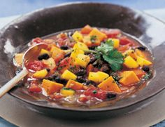 Here's a quick vegetarian version of the Brazilian national dish known as feijoada. This stew entices the eye with the colorful contrast of black beans and sweet potatoes and pleases the palate with nourishing ingredients.