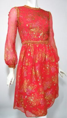 60s dress of metallic gold painted coral silk chiffon by Oscar de La Renta. Sheer crepe silk over solid silk on bodice and skirt, no lining on sleeves...trimmed with gold braid.