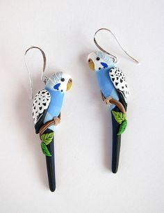 These earrings were hand sculpted from polymer clay without the use of molds or paint. (Each color is a separate piece of clay.)  The birds measures 2 & 1/4 inches long.  These earrings were a custom order and are not for sale. Please see my Flickr profile for further information about my clay art.  Copyright © 2010 Alicia's Creations