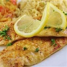 This is a simple recipe for tilapia fillets baked in a scampi-inspired sauce. Cook at 350 for 10 min, flip and add another 10 min ensure fish is flaky and cook for another 2 min if needed. No more than 25 min cooking time or it will dry out. Tilapia Dishes, Tilapia Recipes, Fish Dishes, Seafood Dishes, Fish And Seafood, Fish Recipes, Seafood Recipes, Great Recipes, Cooking Recipes