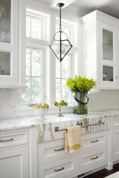 Towel bar on marble slab. Gorgeous kitchen!