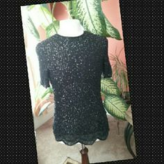 """SHORT SLEEVE SEQUIN TOP Chiffon fabric,  fully lined Sequin design top, back zipper petite large, 29"""" inches long, 36"""" bustline, great condition. Zig zag cut bottom. Black on black great for any occasion. Brilliante  Tops"""