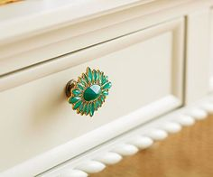 Vintage jewelry becomes a drawer pull