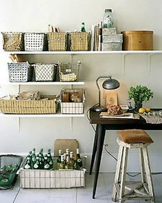 Perfect craft space, worthy or my love of baskets!! office space from Martha Stewart Living, love how it utilizes an entire wall